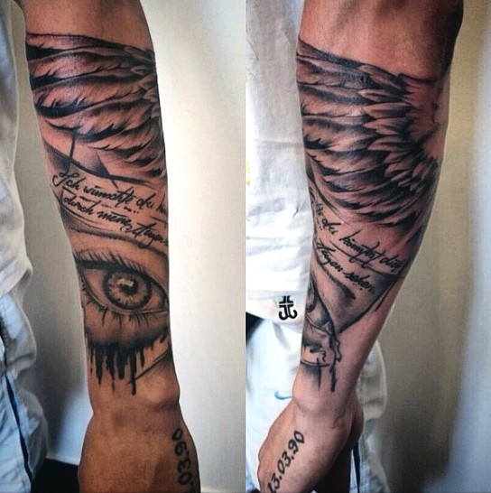 Big black ink memorial tattoo with lettering and wing on arm