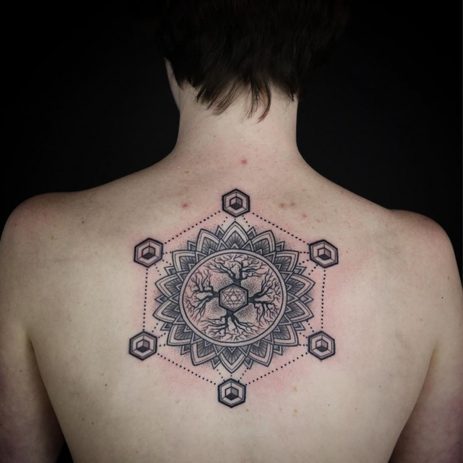 Big black ink mysterious figure tattoo on back with ornamental flower