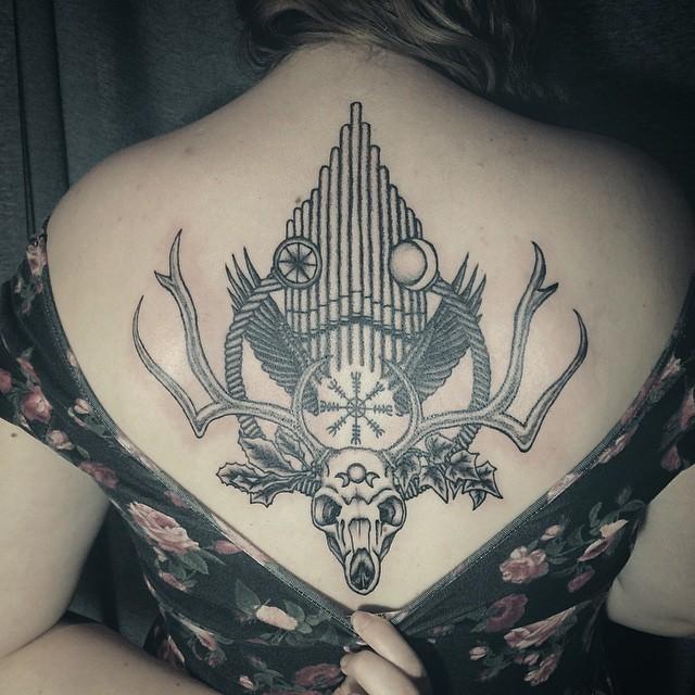 Big black ink mystical cult deer skull tattoo on back with organ