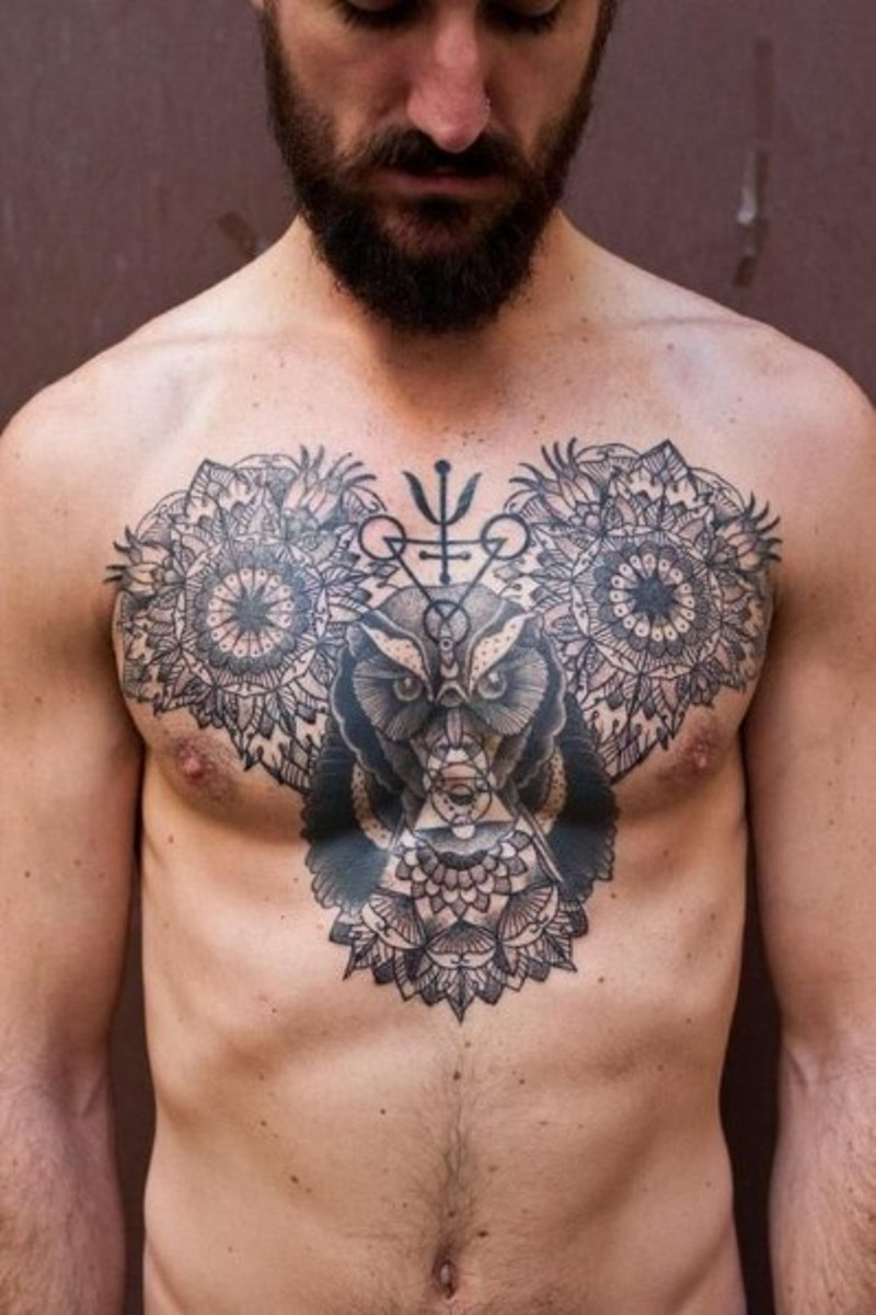 Big black ink mystical tattoo with flowers and owl stylized with symbols tattoo on chest