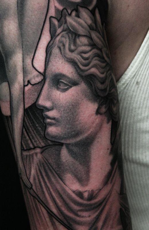Big black ink old school sleeve tattoo of antic statue