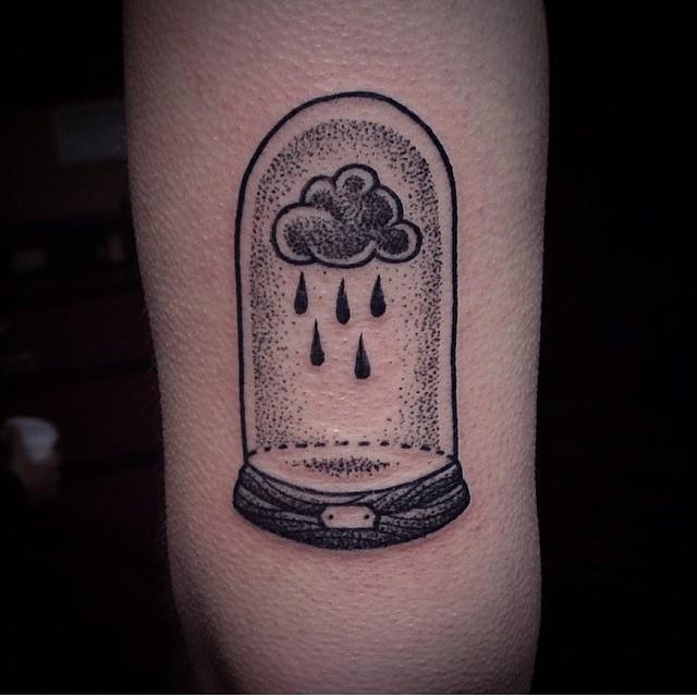 Big black ink rain cloud tattoo on arm