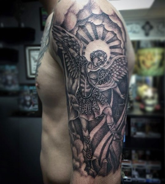 Big black ink religious themed angels tattoo on shoulder