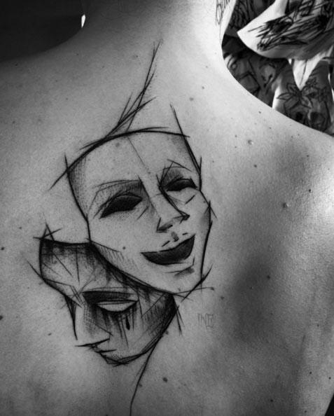 Big black ink sketch style tattoo of sad and happy masks
