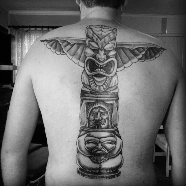 Big black ink tribal Gods statue tattoo on whole back