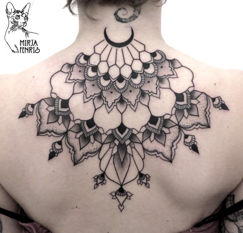 Big black ink upper back tattoo of flower shaped ornaments