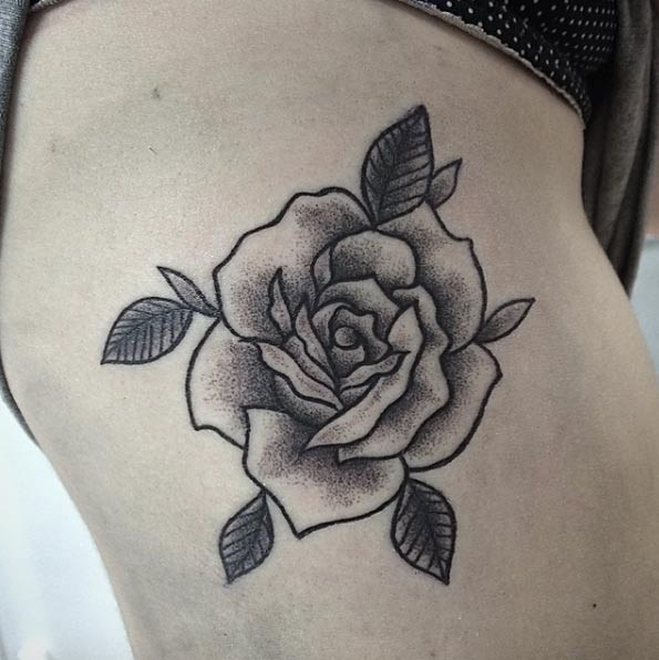 Big black ink usual painted on thigh tattoo of rose with leaves