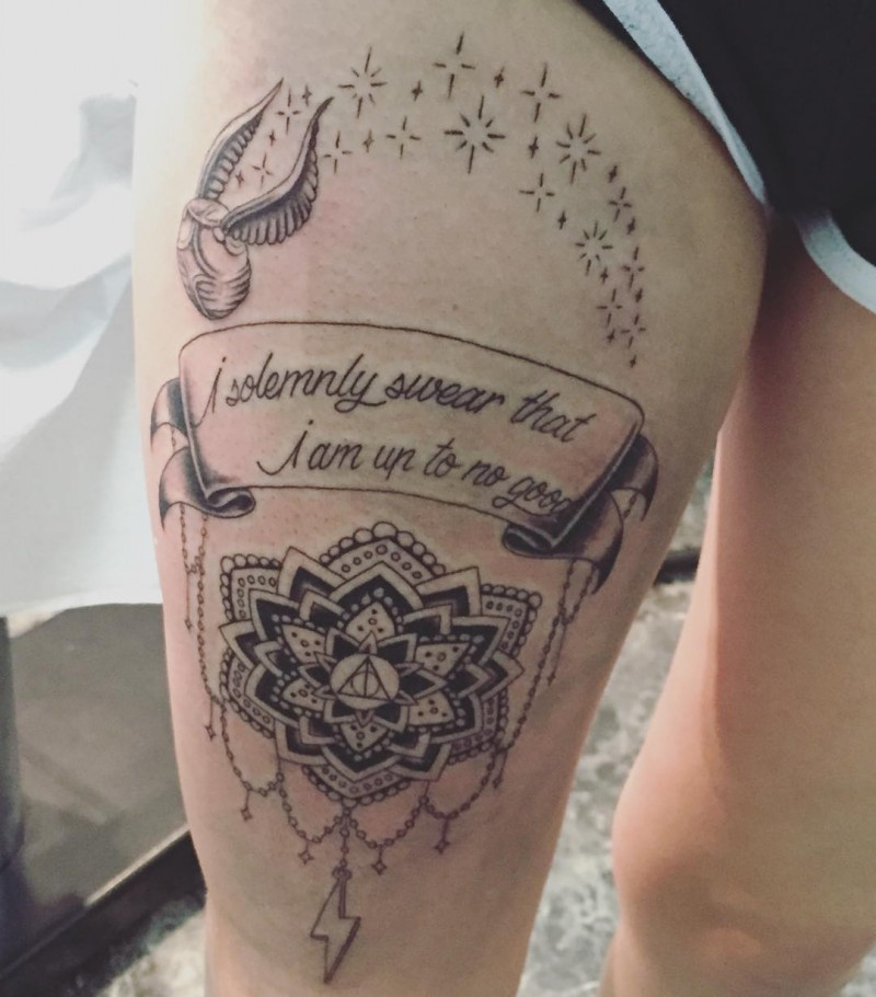 Big black ink very detailed banner with lettering tattoo on thigh stylized with flower, stars and bird