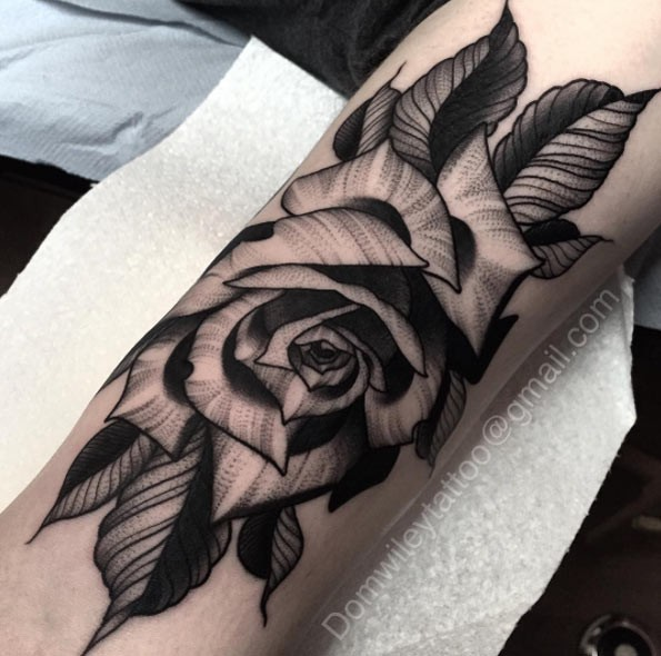 Big black ink very detailed rose flower tattoo on forearm