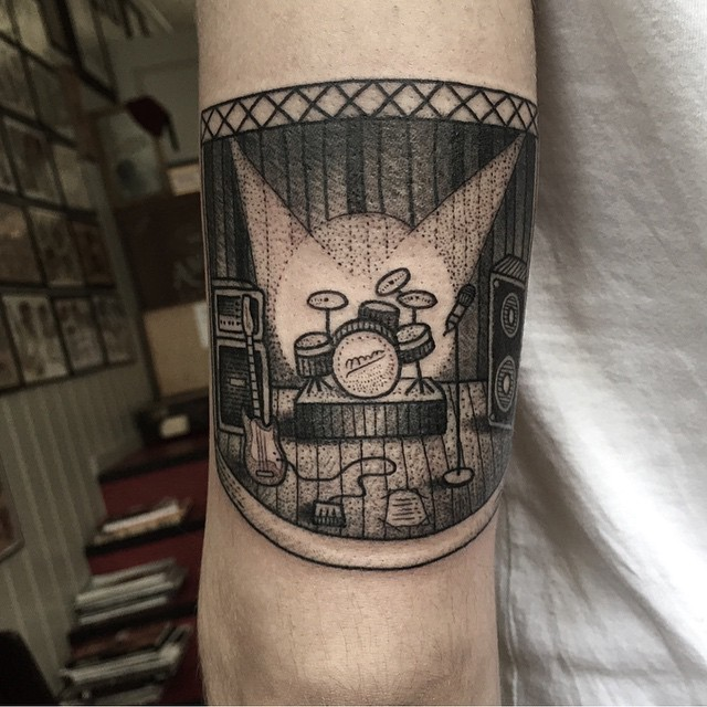 Big black ink vintage style music themed tattoo on arm