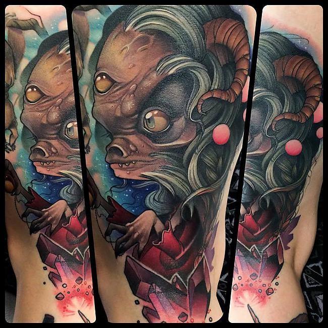 Big cartoon like colored creepy witch tattoo on arm