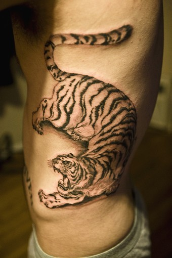Big chinese tiger tattoo on sidepiece