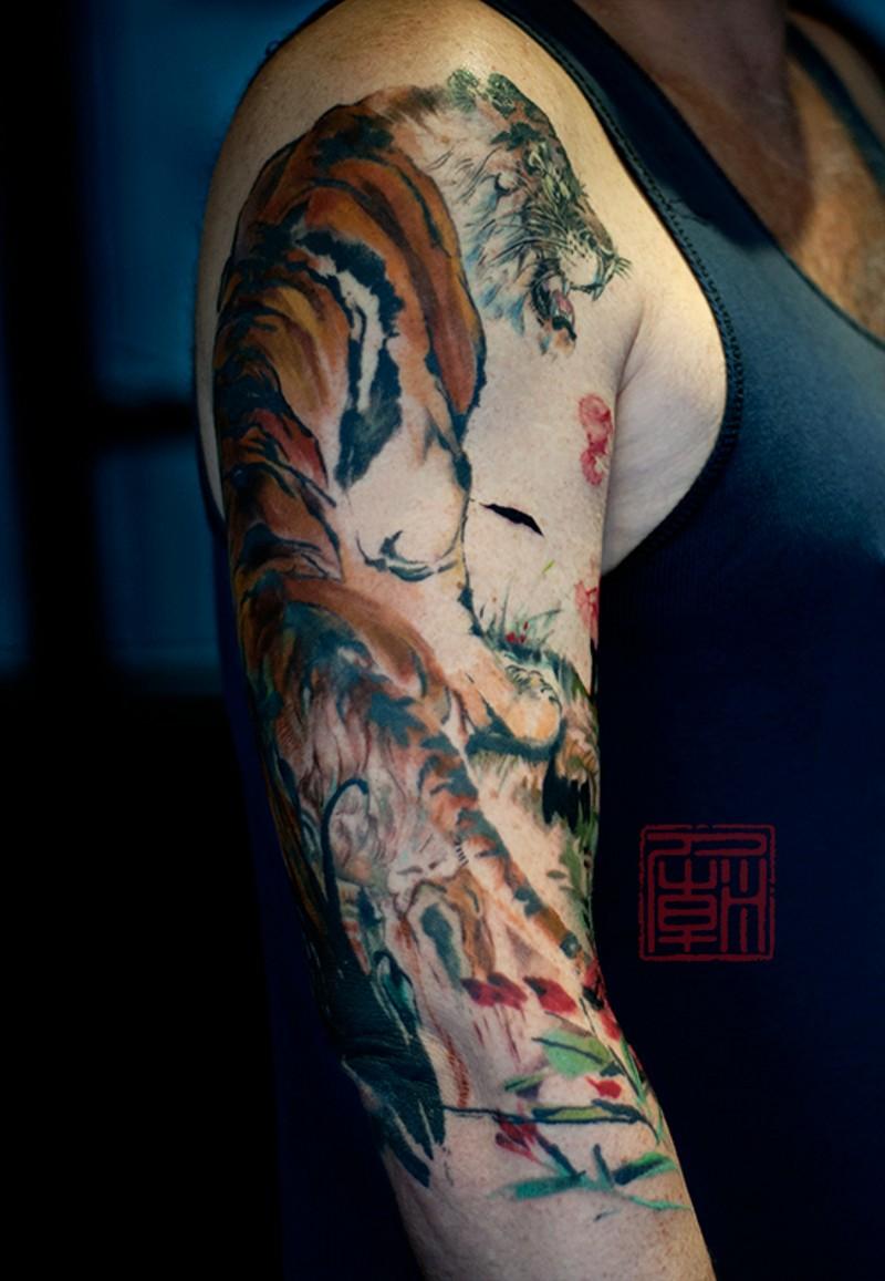 Big colored 3D like multicolored shoulder tattoo of tiger in jungle