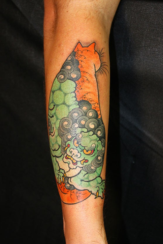 Big colored by horitomo Manmon cat tattoo on arm