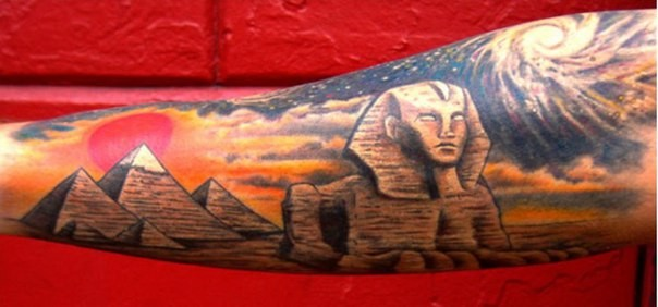 Big colored Egypt themed colored Egypt pyramids tattoo on forearm with Spinx