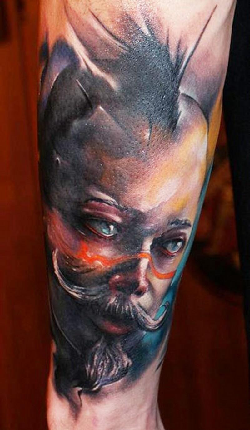 Big colored forearm tattoo of fantasy creature portrait