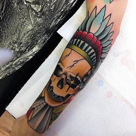 Big colored forearm tattoo of Indian chief skull
