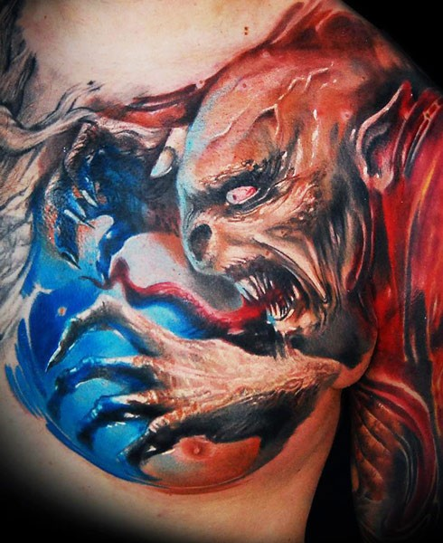 Big colored horror style detailed evil devil tattoo on chest and shoulder