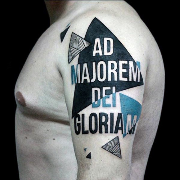 Big colored lettering tattoo on shoulder combined with geometrical figures