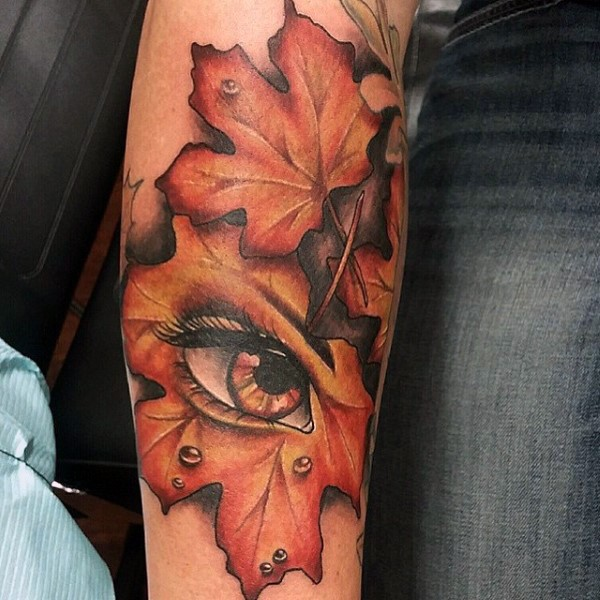 Big colored natural leaf with mystic eye tattoo on arm