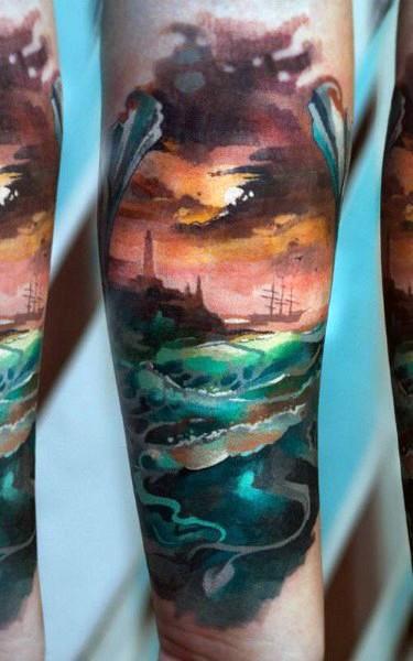 Big colored ocean sunset tattoo on sleeve