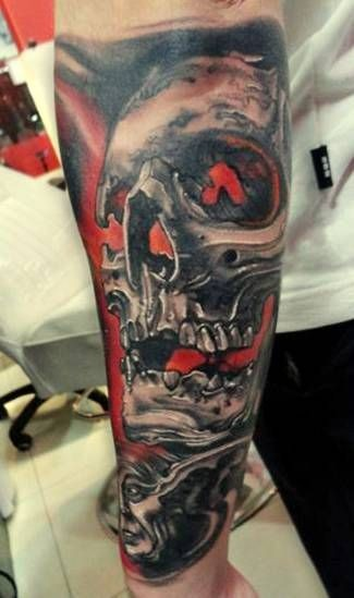Big colored old corrupted skull tattoo on forearm with mystical faces