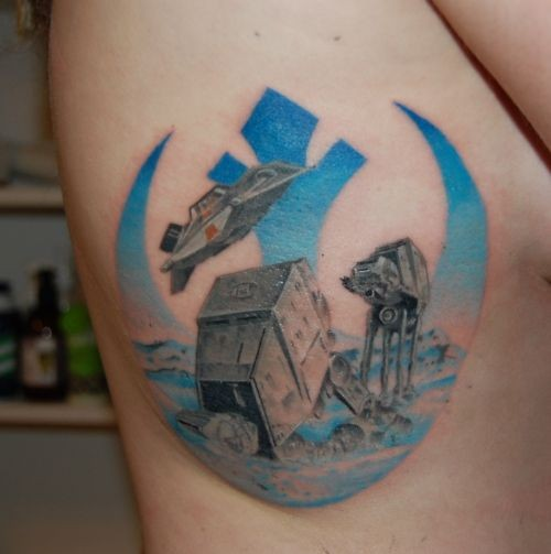 Big colored old school Star Wars themed tattoo on side area