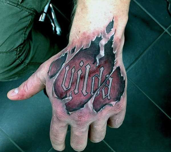 Big colored ripped skin tattoo with lettering on arm