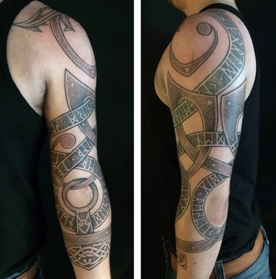 Big colored shoulder tattoo of ancient Celtic symbols and ornaments
