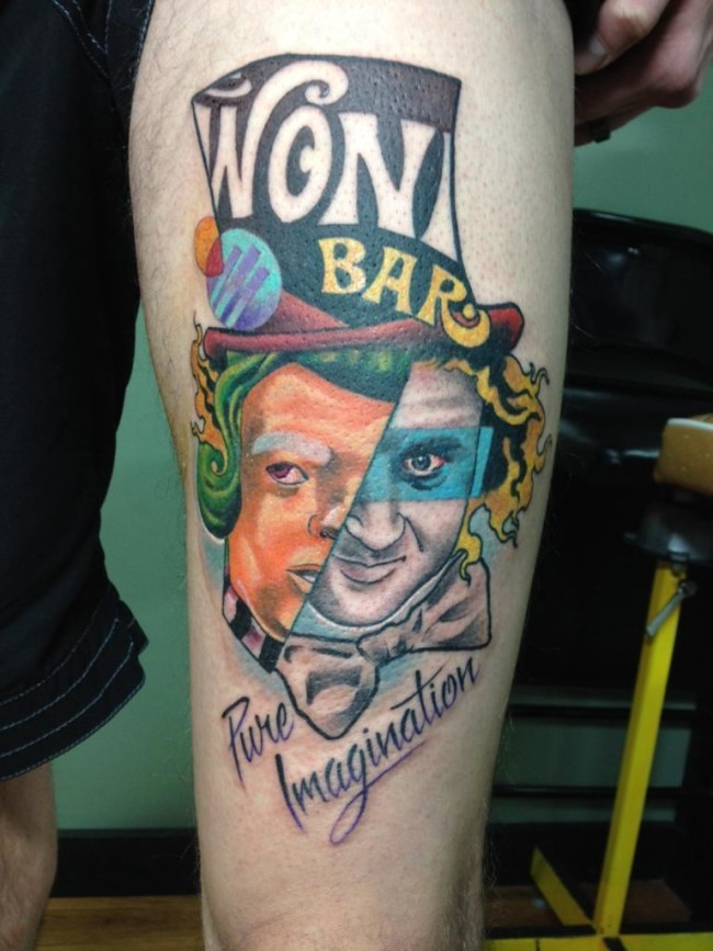 Big colored thigh tattoo of funny ma with lettering