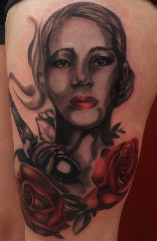 Big colored untidy painted woman with pistol tattoo on thigh with flowers