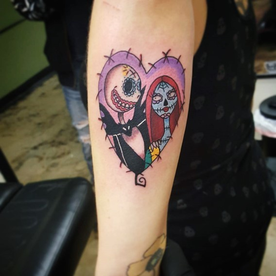 Big colorful heart shaped tattoo on arm with Nightmare before Christmas couple