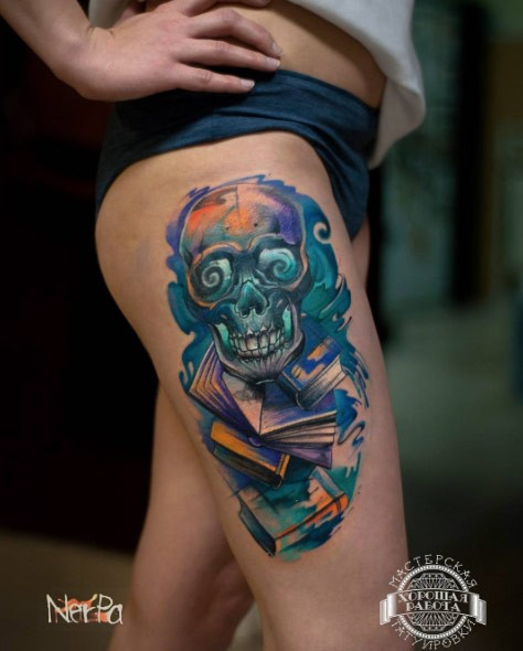 Big colorful mystical demonic magical skull tattoo on thigh stylized with books