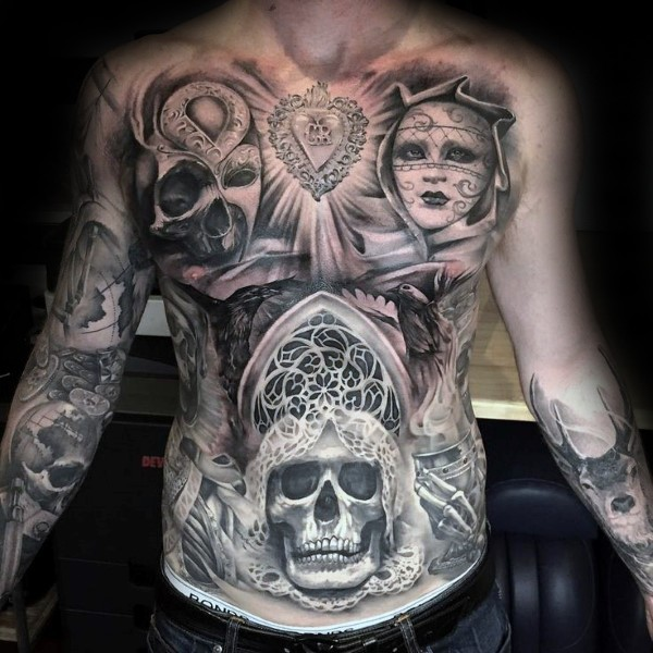 Big creepy looking chest and belly tattoo of various demonic faces and heart