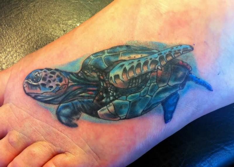Big dark green turtle tattoo on foot