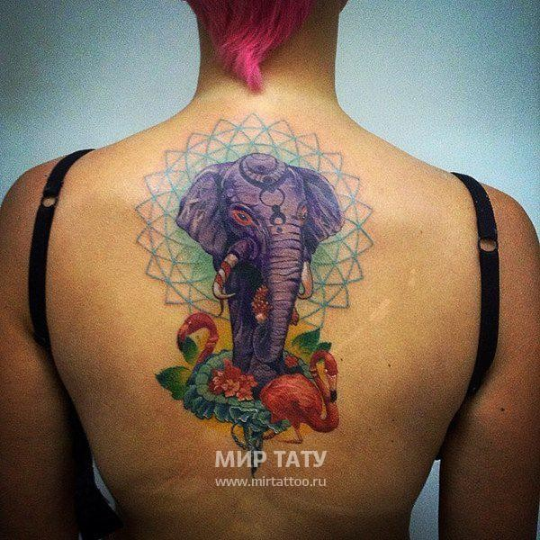 Big fantasy colored big elephant tattoo on back combined with flamingos and flovers