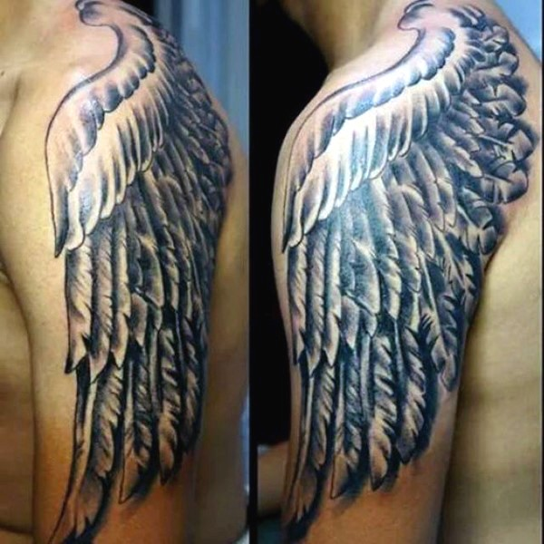 Big fantasy style painted black and white wing tattoo on shoulder