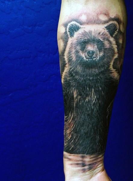Big funny black ink bear tattoo on arm