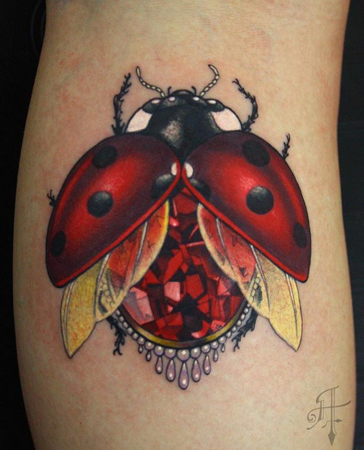 Big gorgeous painted colored leg tattoo of ladybug with diamond