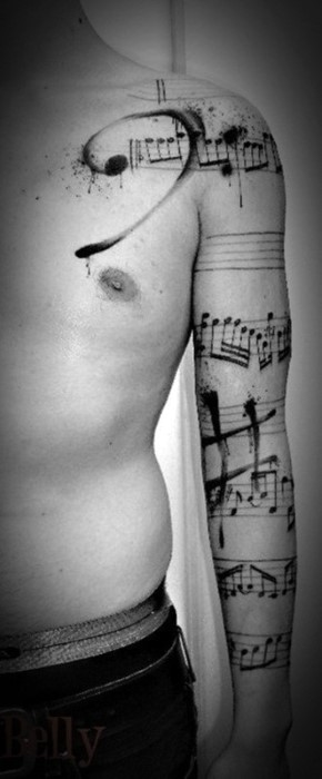 Big great painted black ink music notes tattoo on sleeve