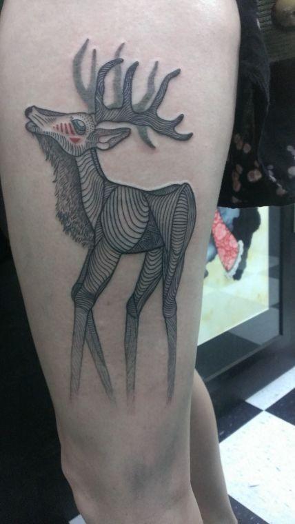 Big half colored big deer tattoo on thigh
