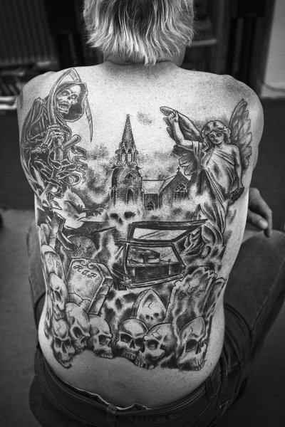 Big homemade like black and white whole black tattoo on various horror symbols with angel statue