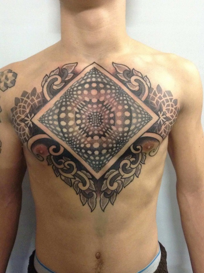 Big illustrative style chest tattoo of interesting ornament