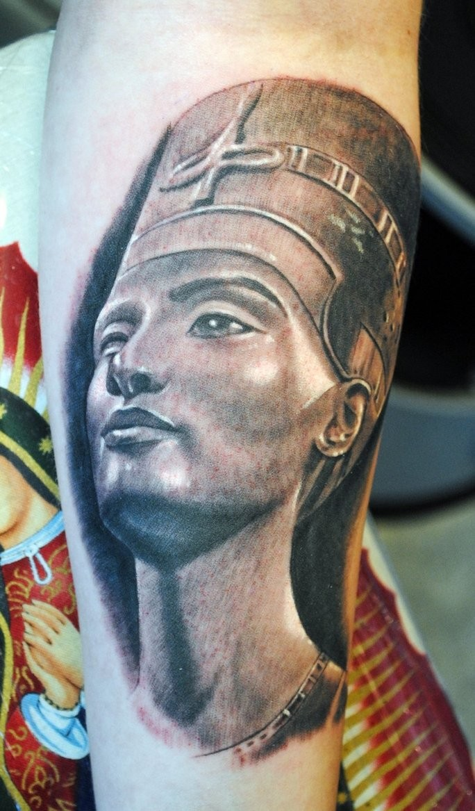 Big illustrative style forearm tattoo of Egypt queen statue