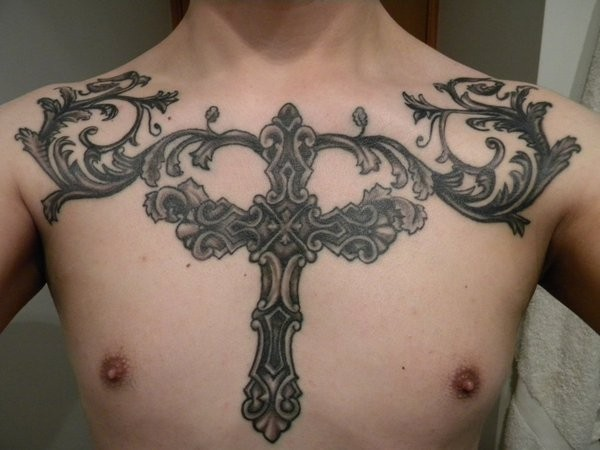 Big iron cross with patterns tattoo on chest