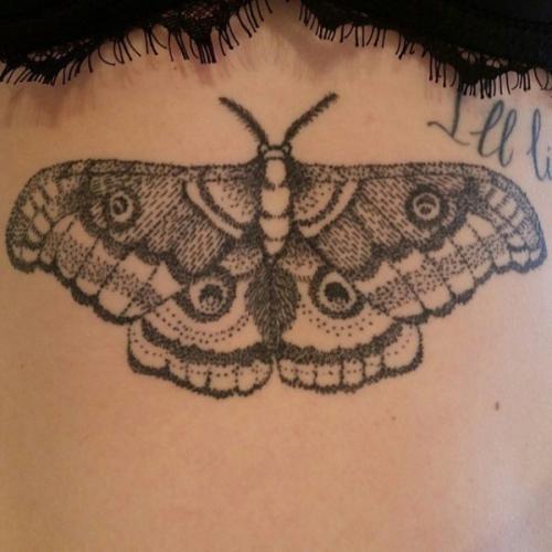 Big moth tattoo on girls body