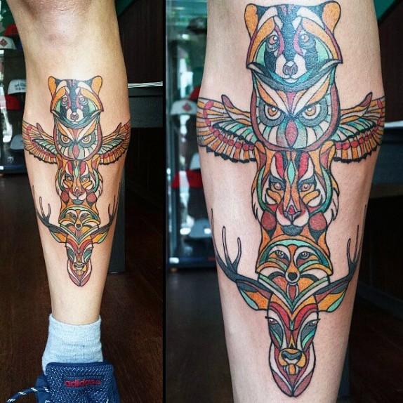 Big multicolored antic tribal statue tattoo on leg