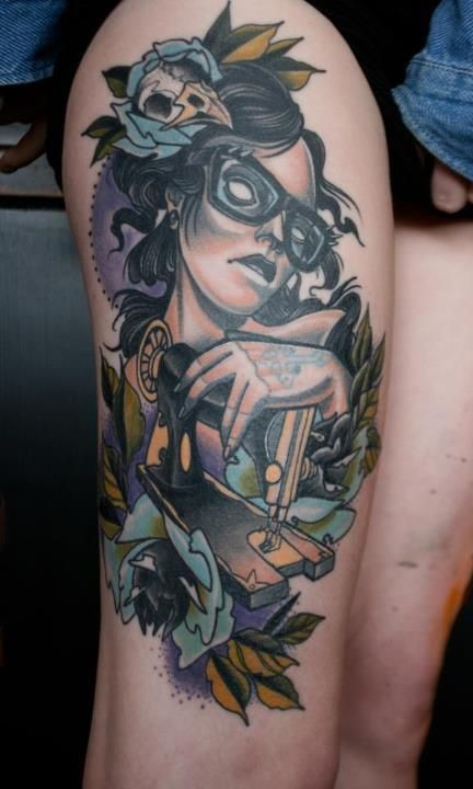 Big multicolored demonic woman with sewing machine tattoo on thigh stylized with flowers
