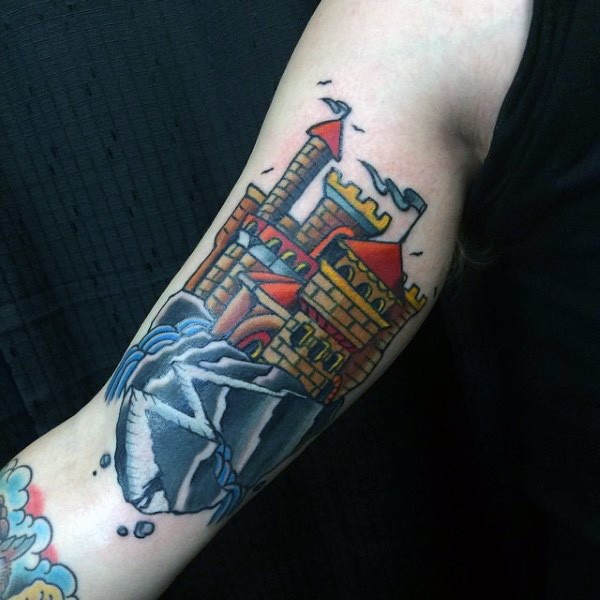 Big multicolored fantasy castle tattoo on arm