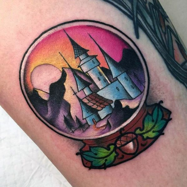 Big multicolored orb with house tattoo on arm